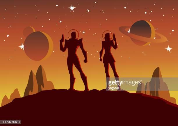 ilustrações, clipart, desenhos animados e ícones de silhueta dos pares dos astronautas do vetor na ilustração do espaço - somente adultos