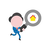 Vector businessman character running and carrying magnifying glass with house