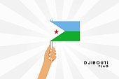 Vector cartoon illustration of human hands hold Djıbouti flag. Isolated object on white background.