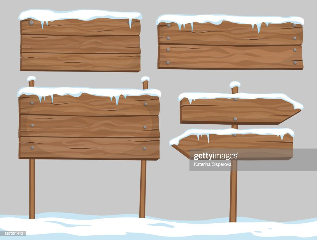 Vector cartoon set of blank wooden signs covered with snow and ice isolated on grey background