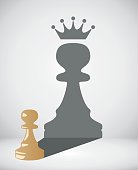 vector chess pawn with the shadow of a big king