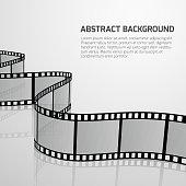 Vector cinema movie background with retro film strip roll