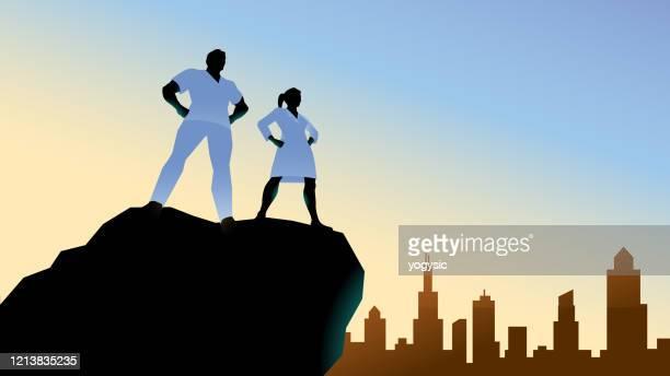 vector doctor superhero couple silhouette stock illustration - scrubs stock illustrations