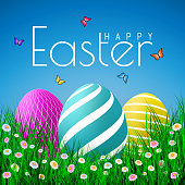 Vector Easter eggs with grass, butterfly and flowers isolated on a blue background. Element for celebratory design