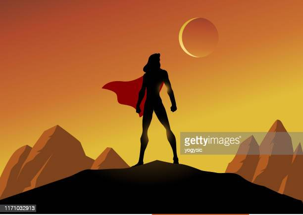 vector female superhero silhouette with mountain scenery background illustration - heroines stock illustrations