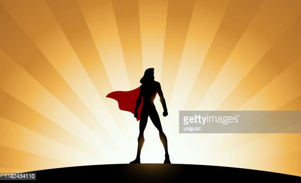 vector female superhero silhouette with sunburst effect in the background - heroes stock illustrations