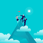 Vector flat illustration with business people standing on mountain peak top holding flag on blue clouded sky background. 2