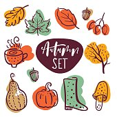 Vector hand drawn style set of autumn symbols: pumpkin, leaves, boots and others.