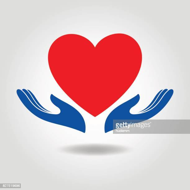Vector heart in hand icon concept