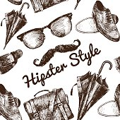 Vector hipster accessories in retro sepia style on seamless pattern