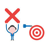 Vector illustration businessman with dart and bulls eye, miss target and holding up x mark