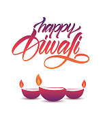 Vector illustration. Colorful Handwritten calligraphic lettering of Happy Diwali with lamps on white background