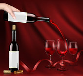 Vector illustration of a hand holding a glass wine bottle and pouring red wine into a glasses