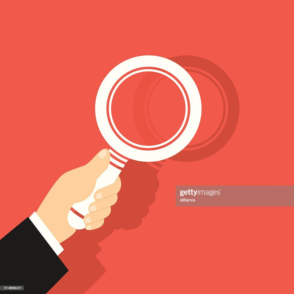 Vector Illustration Of A Magnifying Glass in Hand