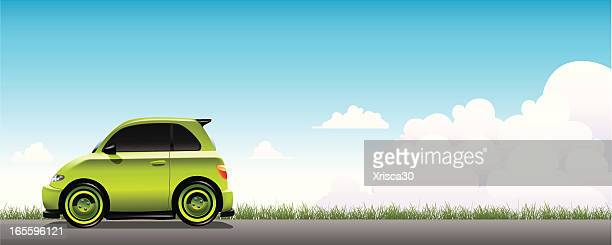 vector illustration of a small green car on a gray road - compact car stock illustrations, clip art, cartoons, & icons