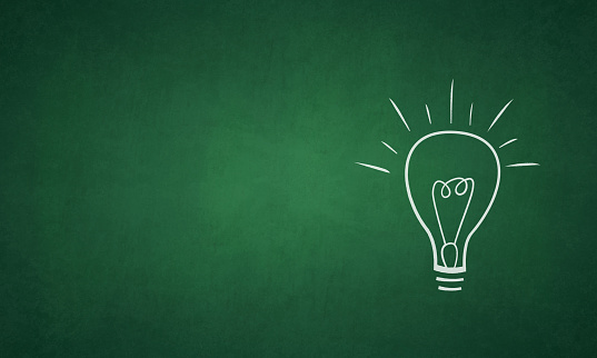 Vector illustration of an ignited light bulb on a grungy green colored blackboard - gettyimageskorea
