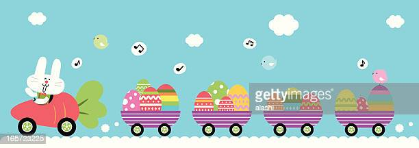vector illustration of easter bunny with egg train - easter egg hunt stock illustrations, clip art, cartoons, & icons