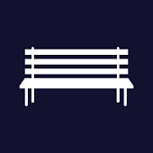 Vector image of the bench. Vector white icon on dark blue background.