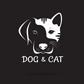Vector of dog and cat face design on a black background. Pet. Animal. Easy editable layered vector illustration.
