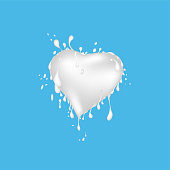 Vector of milk splash shape heart. Splash of milk on blue background.