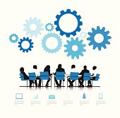 Vector of Silhouettes of Business People Meeting