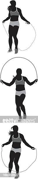 vector of woman jumping with rope - jump rope stock illustrations, clip art, cartoons, & icons