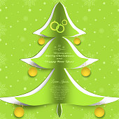 Vector paper art for Merry Christmas and Happy New Year with cutout silhouette in the form of a green Christmas tree, text, hanging yellow balls on the green gradient background.