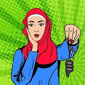Vector pop art muslim woman with keys