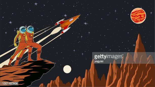 illustrazioni stock, clip art, cartoni animati e icone di tendenza di vector retro astronaut couple on a planet with outer space background stock illustration - missile razzo spaziale