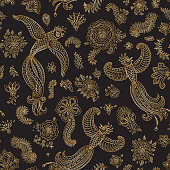 Vector seamless pattern in ethnic style.Exotic flying birds, golden contour thin line fantasy flowers with folk ornaments on a black background. Embroidery, gold wallpaper, textile print, wrapping paper