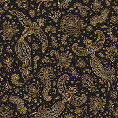 Vector seamless pattern in ethnic style.Exotic flying birds, golden contour thin line drawing with folk ornaments on a black background. Embroidery silhouette, wallpaper, textile print, wrapping paper