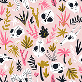 Vector seamless pattern of animal skulls. Background with cute skulls and desert plants on the pink polka dot  background.