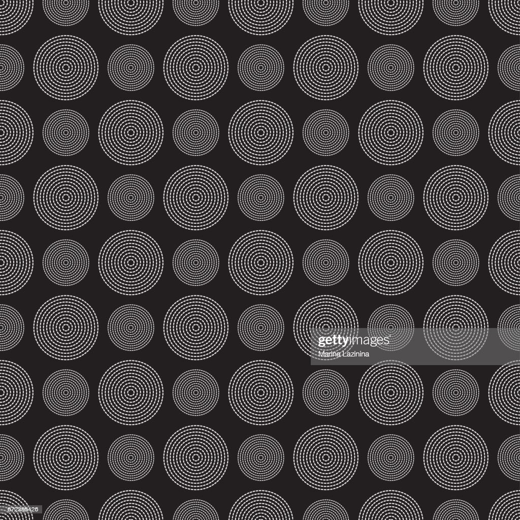 Vector seamless pattern with dotted circles.