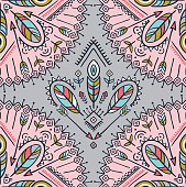 Vector seamless pattern with ethnic arrows, feathers and tribal ornaments.