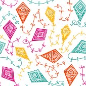 Vector seamless pattern with kites in the sky. Childish design.