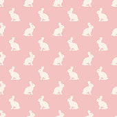 Vector seamless pattern with rabbits on pink background . Seamle