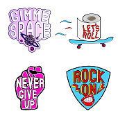 "Vector set of cartoon colorful stickers with phrases, words: ""Never give up"" on pink female fist, ""Rock on"" on guitar mediator, ""Let's Roll"" on toilet paper, ""Gimme space"" with planet."