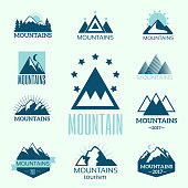 Vector set of mountain exploration vintage emblems and rock silhouette design elements