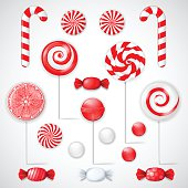 Vector set with different red and white candies and lollipops