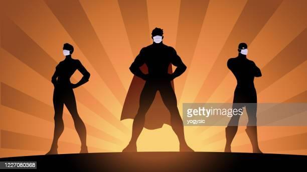 vector social distancing superheroes silhouette stock illustration - cape garment stock illustrations