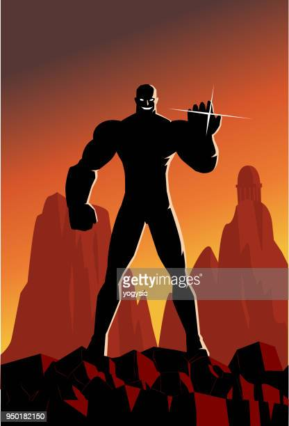 vector super villain silhouette on a mountain - ruler stock illustrations