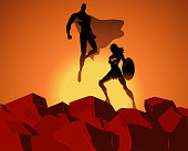 Vector Superhero Couple on Top of  Rocks