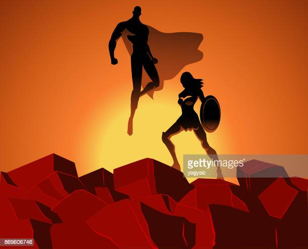 vector superhero couple on top of  rocks - heterosexual couple stock illustrations, clip art, cartoons, & icons