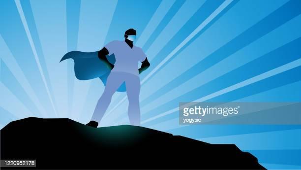 vector superhero healthcare worker silhouette stock illustration - essential services stock illustrations