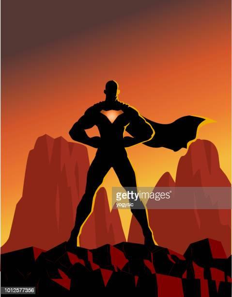vector superhero silhouette on a mountain - mountain logo stock illustrations
