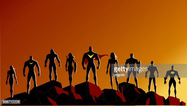vector superhero silhouette set standing on rocks - superhero stock illustrations