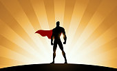 Vector Superhero Silhouette with Sunburst Effect Background