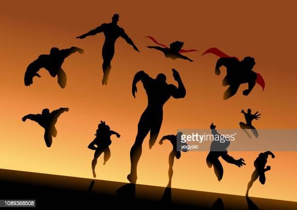 vector superhero team charging forward silhouette - action movie stock illustrations