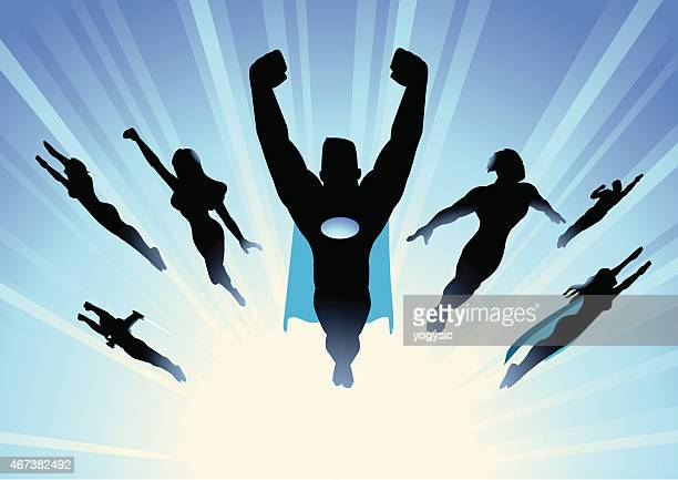 vector superhero team flying in blue burst background - heroes stock illustrations