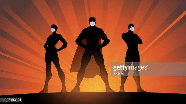 vector superhero team in surgical mask silhouette stock illustration - new normal concept stock illustrations
